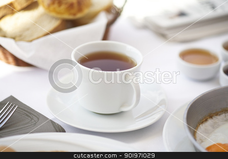 A cup of tea on breakfast table  stock photo, A cup of tea on breakfast table with eggs and pastries by necati turker
