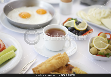 A cup of tea on breakfast table  stock photo, A cup of tea on breakfast table with tomatoes, cucumber, cheeses and olives by necati turker