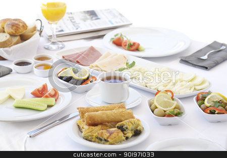Breakfast table with tea and orange juice stock photo, Breakfast table with cheese, tomatoes, olives, cucumber and pastries by necati turker