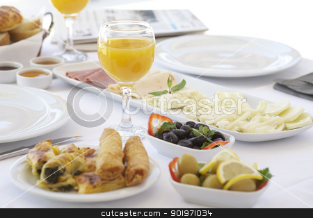 Fresh orange juice on breakfast table  stock photo, Breakfast table with cheese, tomatoes, olives, cucumber and pastries by necati turker