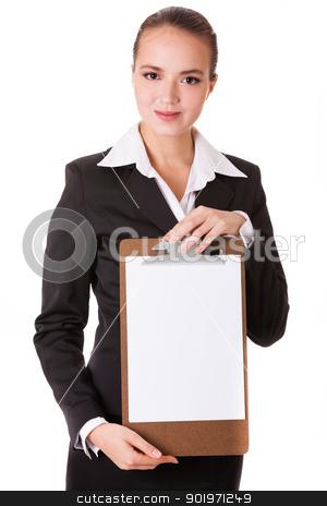 Smiling businesswoman holding a white clear papper stock photo, Smiling businesswoman holding a white clear paper on a holder isolated on white background by Iryna Rasko
