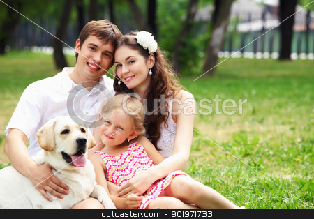 Happy family having fun outdoors stock photo, Young Family Outdoors in summer park with a dog by Sergey Nivens