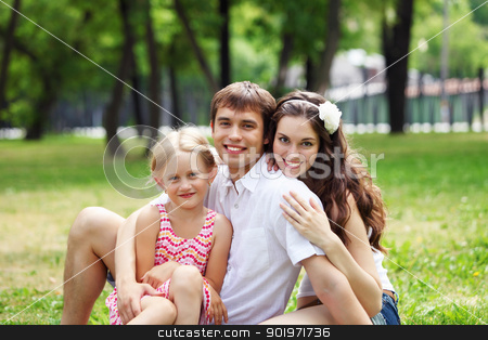 happy family having fun outdoors stock photo, Young Family Outdoors on the grass in Park in summer by Sergey Nivens