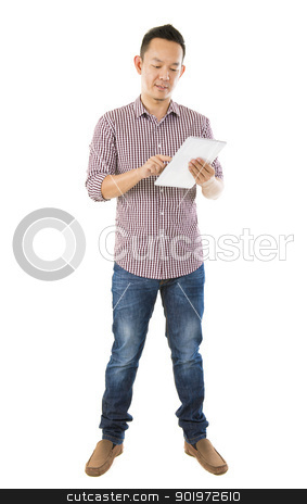 Fullbody Asian man using tablet stock photo, Fullbody Asian man using tablet computer standing over white background by szefei
