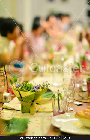 Reunion party stock photo, Reunion party in warm ambient , focus on the flower bouquet on dining table. by szefei