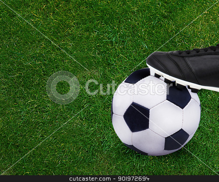 Football sport stock photo, Football sport, kid playing soccerand holding soccer ball. by Designsstock