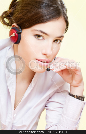 pretty female operater with headphones stock photo, Close up of a pretty female operator with headphones by iMarin