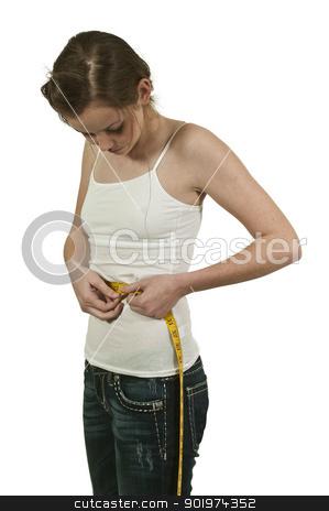 Woman Measuring Her Waist stock photo, Beautiful woman measuring her waist with a tailors tape by Robert Byron