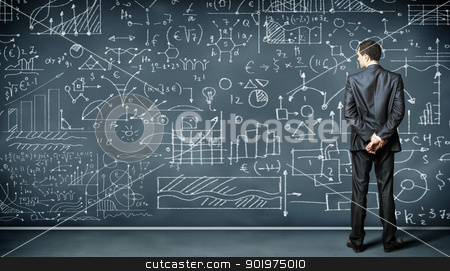 Business person against the blackboard stock photo, Business person standing against the blackboard with a lot of data written on it by Sergey Nivens