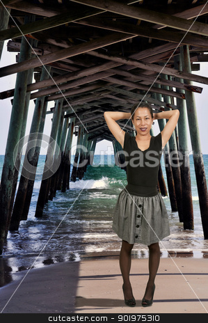 Woma Under Fishing Pier stock photo, Hispanic Latino woman on the underside of an ocean Fishing Pier  by Robert Byron