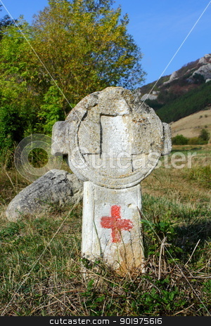 old cross with touristic sign stock photo, old stone cross with touristic sign on a hiking trail witch crosses an abandoned cemetery near Rimetea, Romania by coroiu octavian