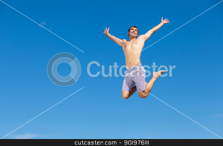 At The Beach stock photo, Portrait of a happy young man having fun on the beach on a summer vacation. by Sergey Nivens
