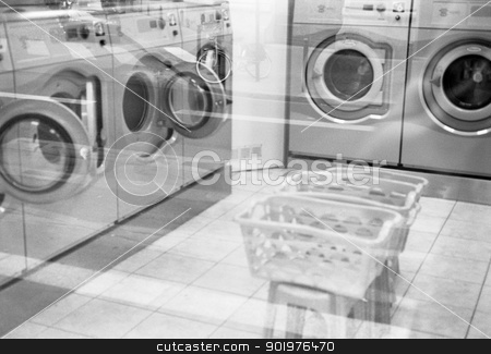 Washing machines in a laundrette stock photo, Black and white image through a window of washing machines in a commercial laundrette in Paris, France by pcooklin