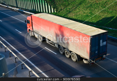 Transportation stock photo, Red truck on a highway by Alexey Popov