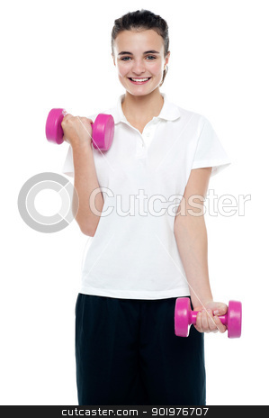 Smiling fitness teenage girl lifting weights stock photo, Smiling fitness teenage girl lifting weights. Exercising with pink dumbbells by Ishay Botbol