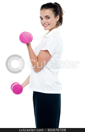 Side pose of girl with dumbbells working out stock photo, Side pose of girl with dumbbells working out over white background by Ishay Botbol