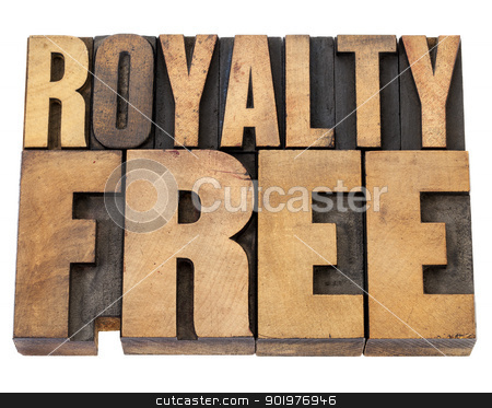 royalty free in wood type stock photo, royalty free - isolated text in  vintage letterpress wood type by Marek Uliasz