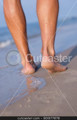 Bare feet at the sea stock photo, Closeup of man's feet at the shore by Kamila Starzycka