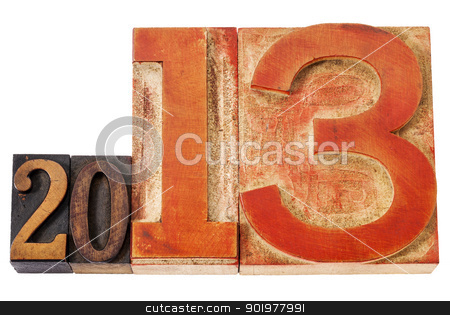 year 2013 in wood type stock photo, year 2013  - isolated text in vintage letterpress wood type, mixed fonts with oversized number thirteen by Marek Uliasz