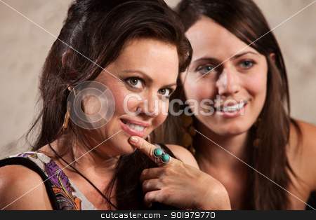 Sexy Women Looking Over stock photo, Sexy brunette females looking over and smiling by Scott Griessel
