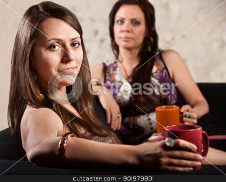 Smiling Woman with Serious Friend stock photo, Beautiful grinning white woman with serious friend in background by Scott Griessel