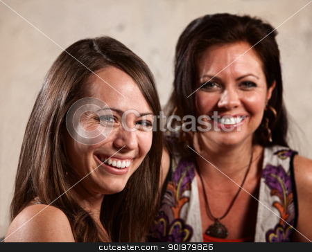 Two Pretty Women Laughing stock photo, Two white women smiling and laughing together by Scott Griessel