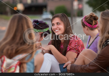 Teenage European Girl with Friends stock photo, Cute teenage European girl sitting outside with four friends by Scott Griessel