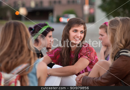Five Girls Sitting Outside stock photo, Group of five girls talking and sitting together by Scott Griessel