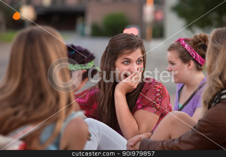 Embarrassed Teen with Hand on Mouth stock photo, Embarrassed teenage girl with hand on mouth among friends by Scott Griessel
