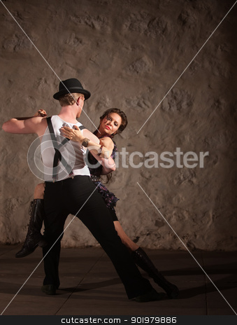 Passionate Dancing in Urban Setting stock photo, Passionate dancers performing tango style in urban setting by Scott Griessel