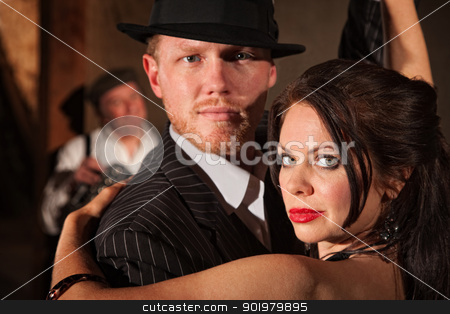 1920s Style Couple Dancing stock photo, 1920s style couple dancing with musician in background by Scott Griessel