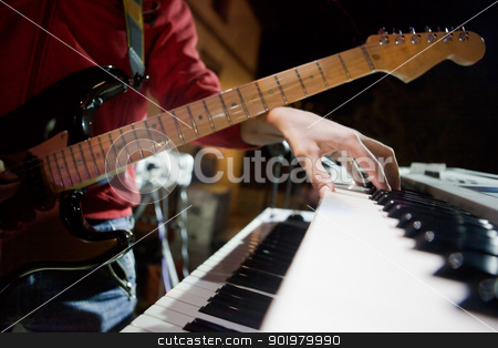 Musician in concert stock photo, Close up image of musician with piano and guitar by carloscastilla