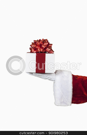 Santa Holding a Gift stock photo, Santa holding a christmas present, includes clipping path by Bryan Mullennix