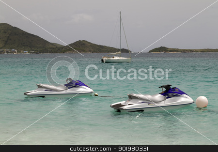 Jet Skies stock photo, Two jet skies tied up in the Caribbean Sea by Kevin Tietz