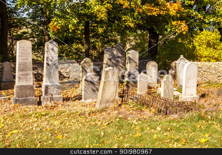 forgotten and unkempt Jewish cemetery with the strangers stock photo, forgotten and unkempt Jewish cemetery with the strangers by Artush