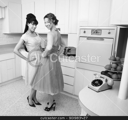 Happy Women stock photo, Happy Caucasian housewives in a retro kitchen with hand on hips  by Scott Griessel