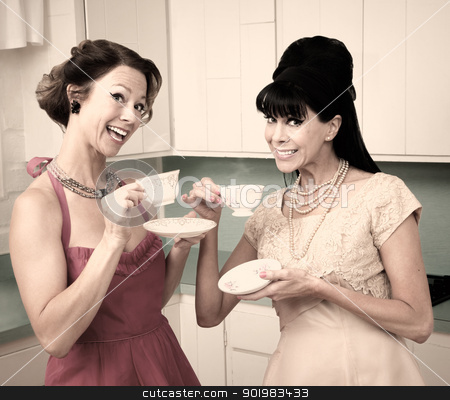 Women Enjoying Coffee stock photo, Two retro style women enjoying tea in the kitchen by Scott Griessel