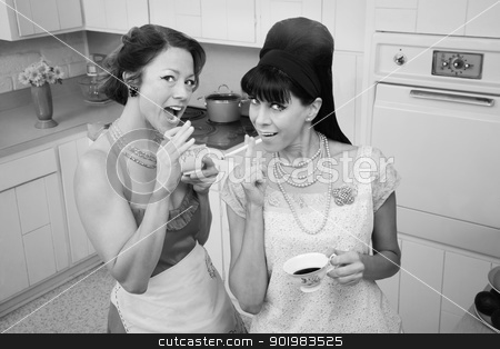 Women Smoking And Drinking Coffee  stock photo, Two women smoke cigarettes while having coffee in a retro kitchen scene by Scott Griessel