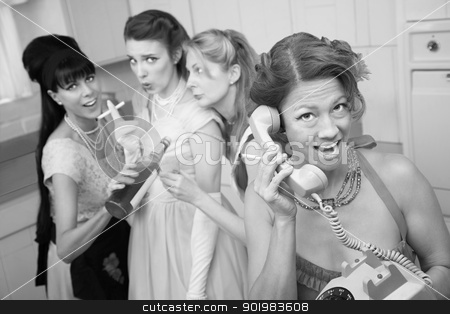 Excited Woman On Phone Call stock photo, Excited woman on phone while friends drink and smoke in the kitchen by Scott Griessel