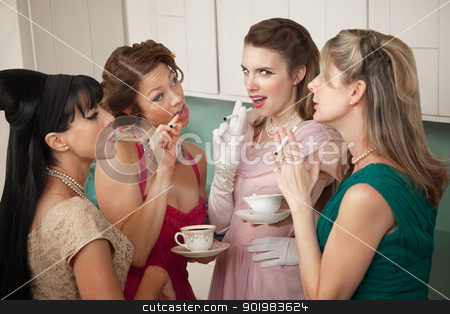 Women Smoking Cigarette  stock photo, Four retro-styled women smoking cigarettes and drinking coffee in a kitchen by Scott Griessel