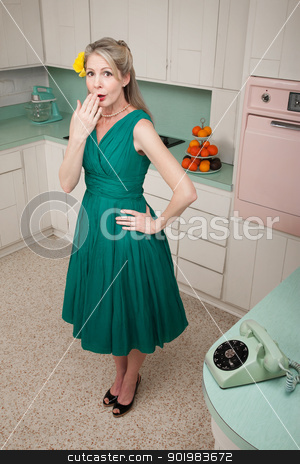 Forgetful Woman stock photo, Forgetful middle-aged Caucasian woman with hand on hip in retro-styled kitchen scene by Scott Griessel