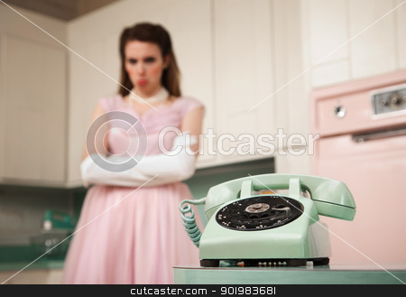 Bride Waiting By The Telephone stock photo, Bride waits by the phone in a retro-style kitchen scene by Scott Griessel