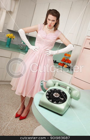 Angry Woman stock photo, Pouting Caucasian woman with hands on hips in a retro-styled kitchen scene by Scott Griessel