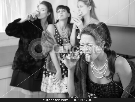 Woman Reacts to a Strong Drink stock photo, Woman reacts to strong alcohol while friends smoke and drink in the kitchen by Scott Griessel