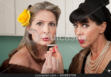 Women Smoking Weed  stock photo, Two retro-styled Caucasian women in mink coats smoke weed  by Scott Griessel