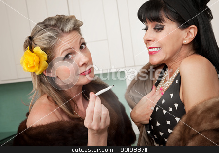Women Smoking Marijuana stock photo, Two wealthy Caucasian women smoking marijuana in the kitchen  by Scott Griessel