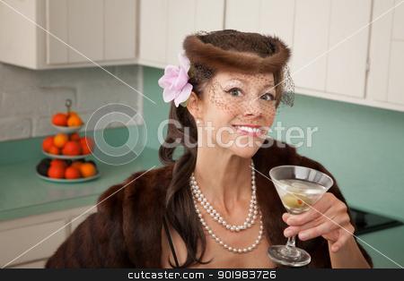 Woman Enjoying Martini stock photo, Caucasian woman wearing veil and mink coat enjoying martini in kitchen  by Scott Griessel