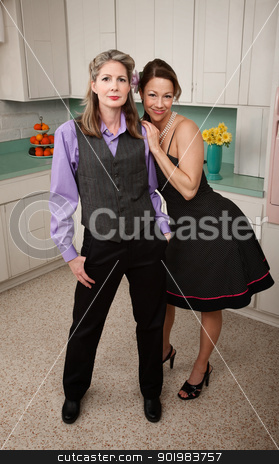 Happy Women stock photo, Two happy women standing together in kitchen by Scott Griessel