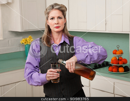 Woman in drag pouring a drink stock photo, Woman in drag pouring alcohol into a glass by Scott Griessel