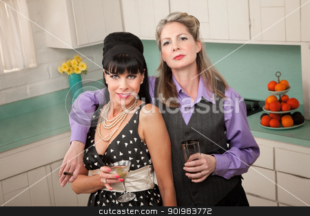 Women Enjoying a Drink stock photo, Lesbian couple with drinks and cigar in a retro-style kitchen by Scott Griessel